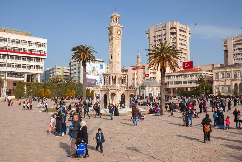 Onak Square view. Izmir, Turkey. Izmir, Turkey - February 5, 2015: Konak Square view. Ordinary people walk near the historical clock tower. It was built in 1901 royalty free stock photos