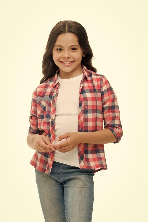 Onbezorgd en toevallig Van het meisjes kijkt de leuke geruite overhemd en denim broek gelukkige vrolijk Gelukkige geniet van onbe royalty-vrije stock foto's