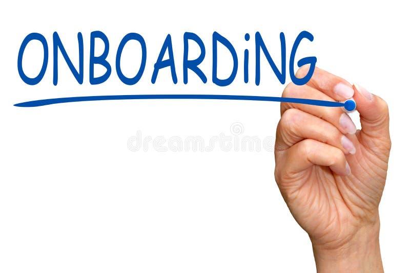 Onboarding -有笔文字文本的女性手 免版税库存图片