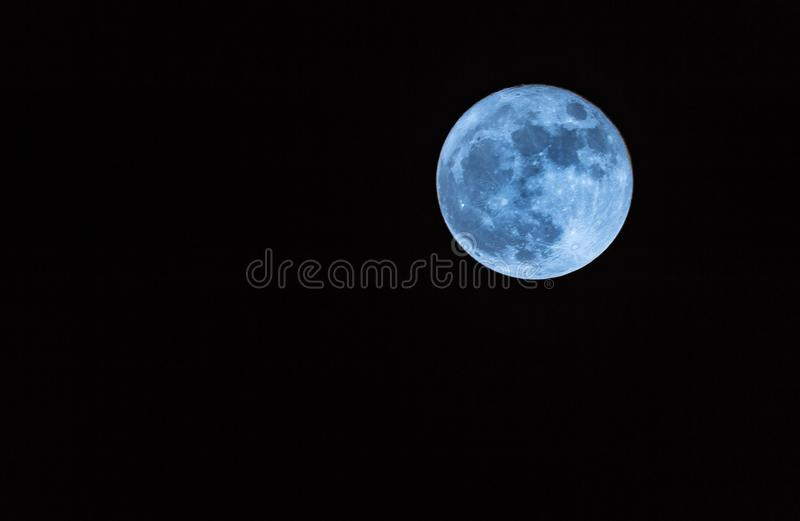 Once in a blue moon stock photography