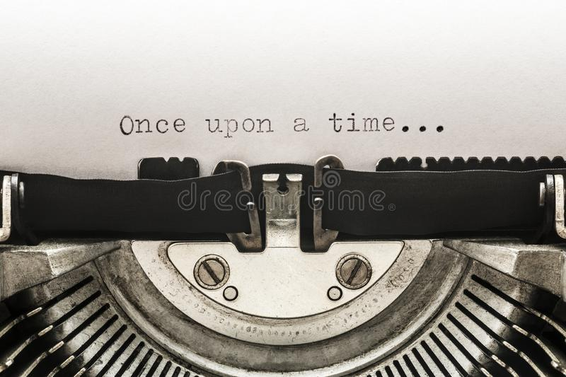 Once upon a time typed on a vintage typewriter. Macro shot stock photography