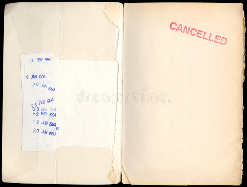 Once was a library book. Cancelled library book - 1994 due date stamps and the remnants of the first page remain stock photos