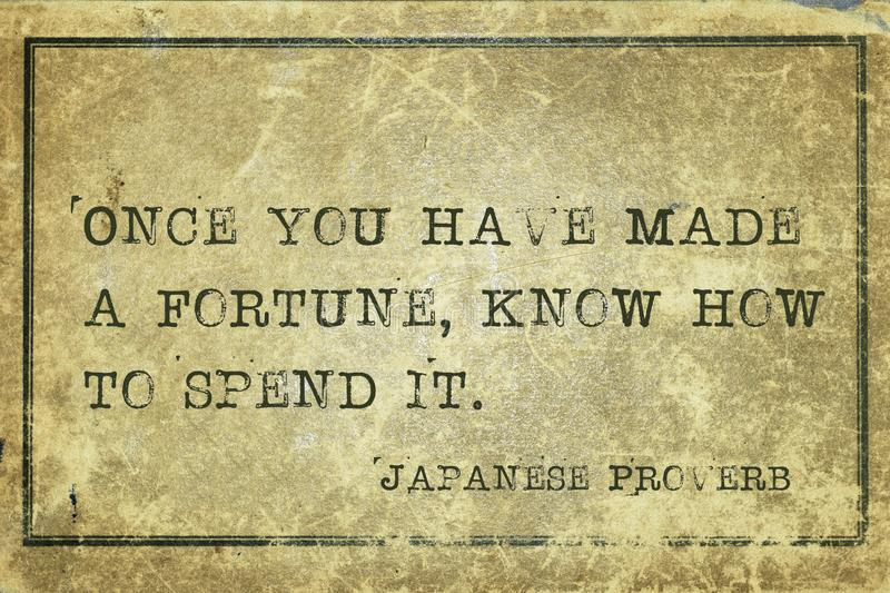 Fortune spend JP. Once you have made a fortune - ancient Japanese proverb printed on grunge vintage cardboard stock illustration