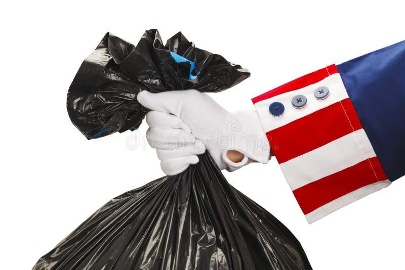 Oncle Sam Taking Out Trash image libre de droits