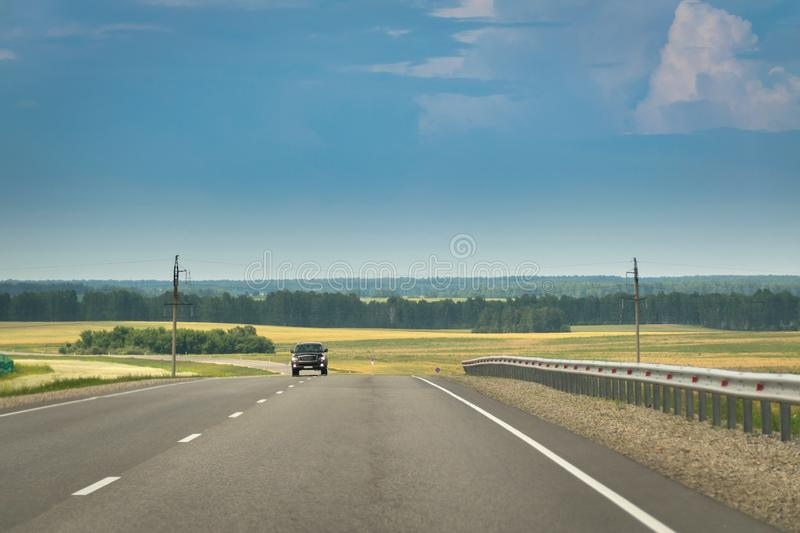 Oncoming Car On A Highway In Countryside. Cloudy, Stormy Sky. Oncoming Car On A Highway In Countryside. Cloudy, Stormy Sky royalty free stock photos