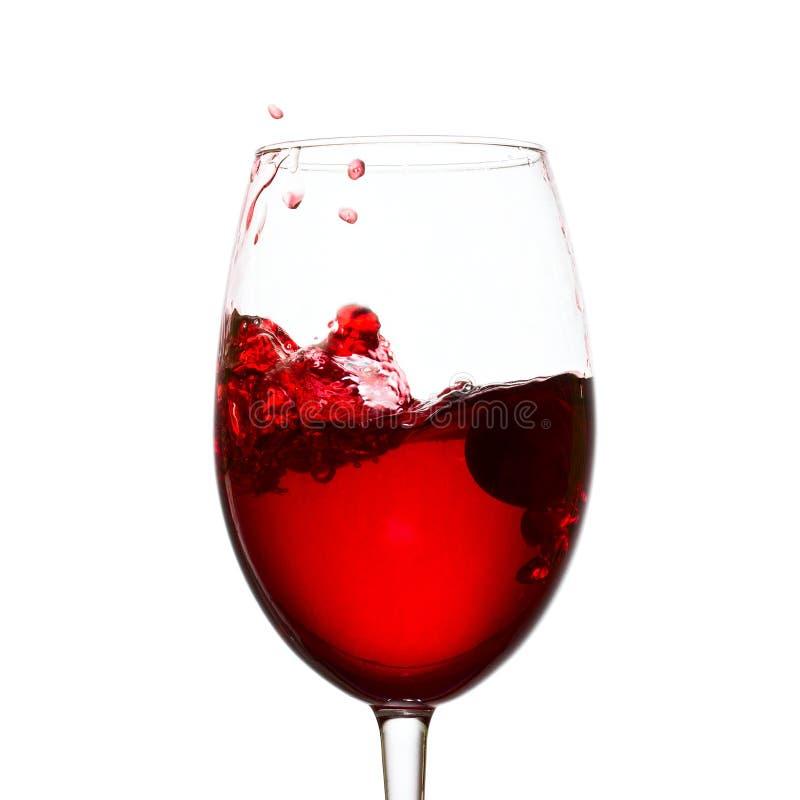 Onda d'urto di vino rosso in un vetro fotografie stock libere da diritti