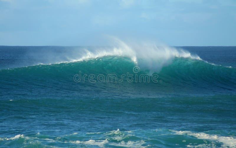 Onda da praia do por do sol foto de stock royalty free
