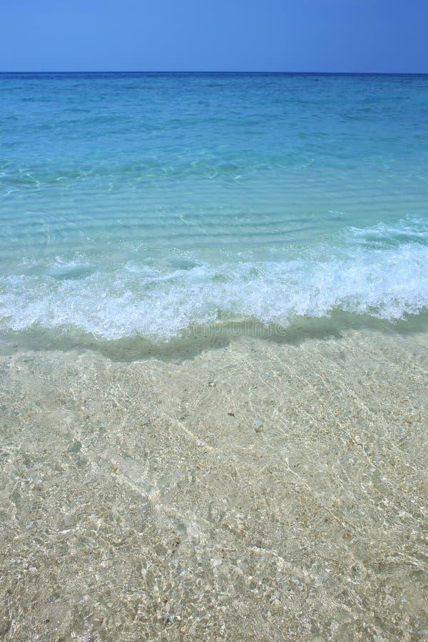 Onda de la agua y de la arena de mar fotografía de archivo libre de regalías