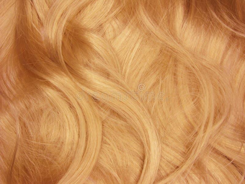 Ondas vermelhas do cabelo como o fundo da textura fotografia de stock royalty free