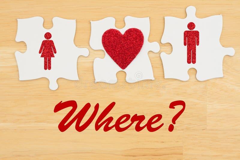 Onde encontrar o amor, as três partes do enigma com um coração e um homem e uma mulher foto de stock royalty free