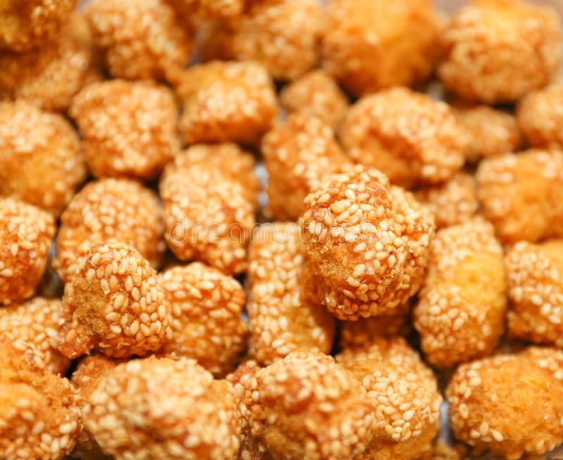 Onde-onde. indonesian traditional street food. Glutinous rice flour and stuffed inside a green bean paste with sesame seeds royalty free stock photo