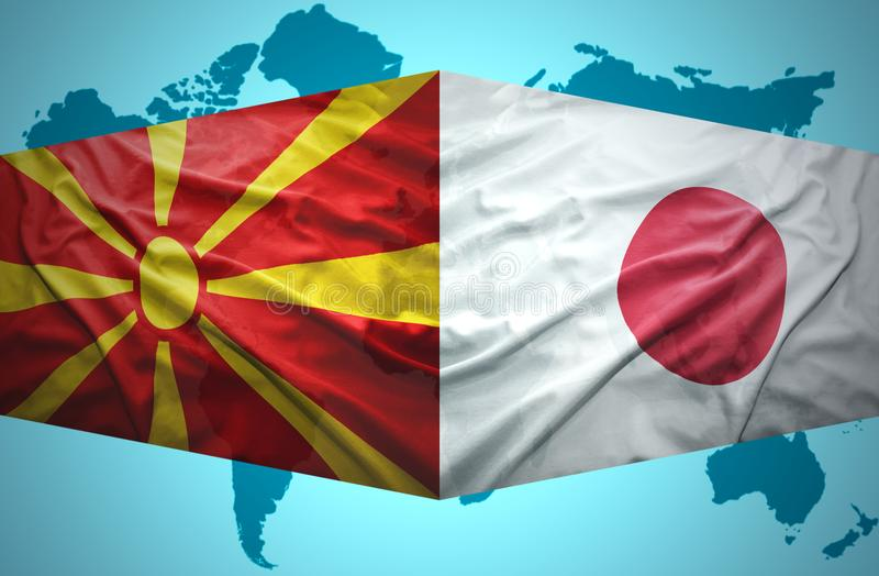 Ondeggiamento delle bandiere macedoni e giapponesi royalty illustrazione gratis