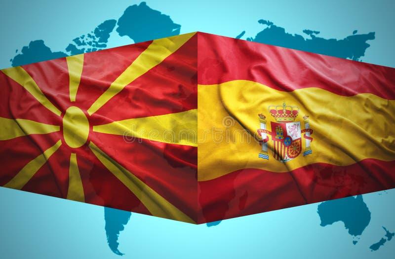 Ondeggiamento delle bandiere macedoni e spagnole royalty illustrazione gratis