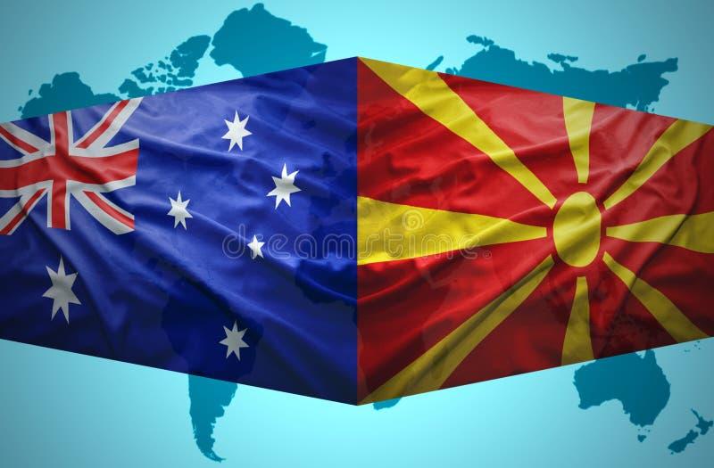 Ondeggiamento delle bandiere macedoni ed australiane illustrazione di stock