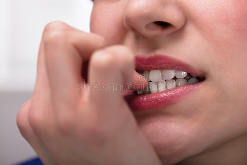 Onderneemster Biting Her Fingernail stock afbeeldingen