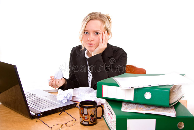 Onderneemster in bureau stock foto