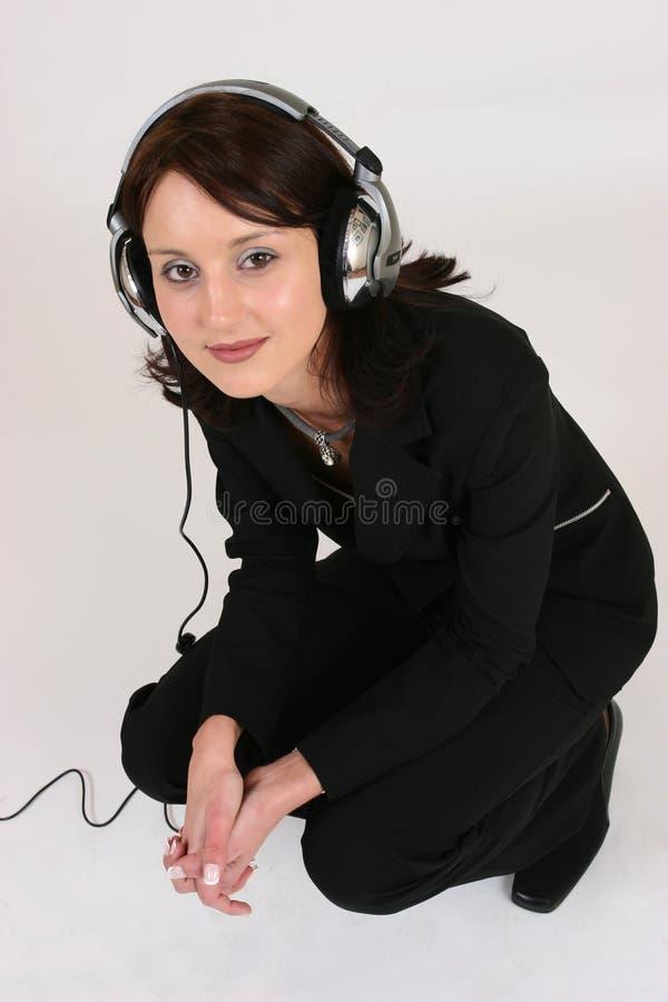 Download Onderneemster Die Aan Haar Favoriete Muziek Luistert Stock Foto - Afbeelding bestaande uit sexy, hoofdtelefoons: 295240