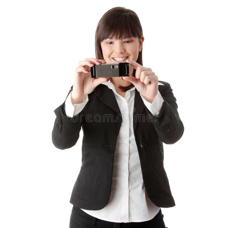 Onderneemster die celtelefoon met behulp van royalty-vrije stock foto's