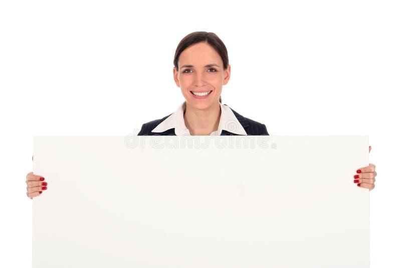 Onderneemster die lege affiche houdt stock afbeelding
