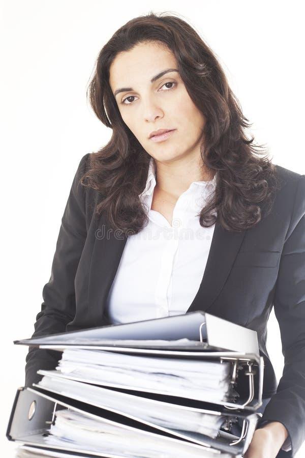 Onderneemster in het bureau wordt vermoeid dat stock foto's
