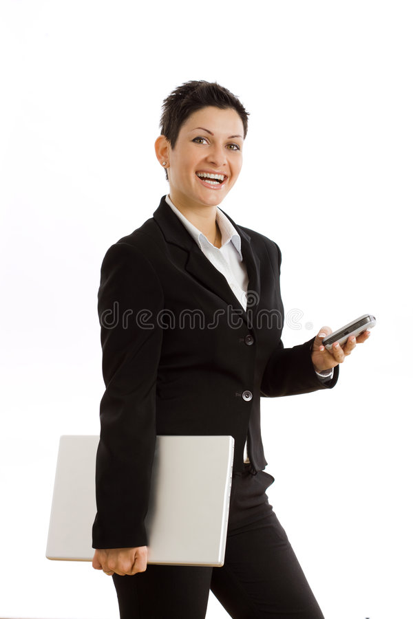 Onderneemster met cellphone en geïsoleerda laptop stock foto