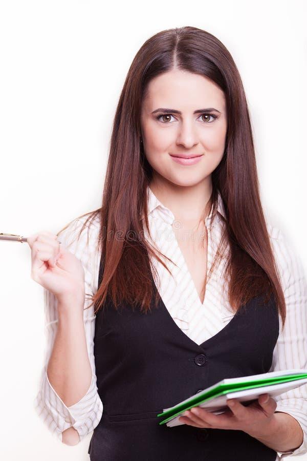 Onderneemster met een notitieboekje in haar geïsoleerde handen volledige lengte royalty-vrije stock foto