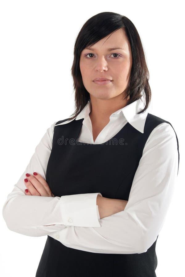 Onderneemster met haar gekruiste wapens stock afbeelding