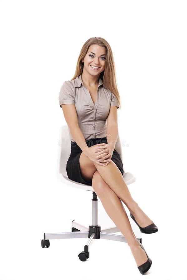 Onderneemster op witte stoel stock foto's