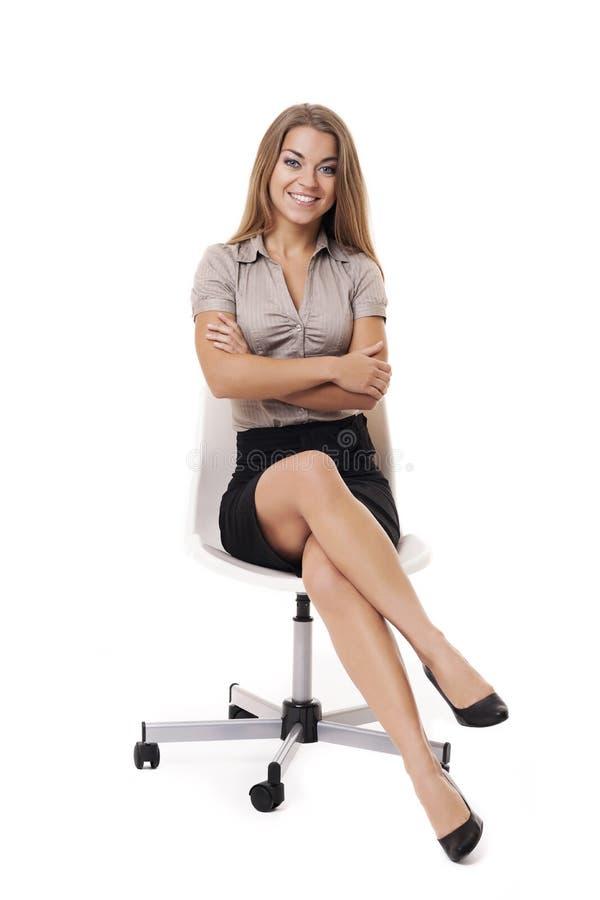 Onderneemster op witte stoel royalty-vrije stock afbeeldingen
