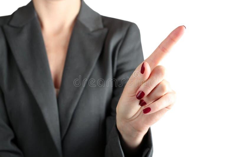 Onderneemster Touching iets door vinger stock foto's
