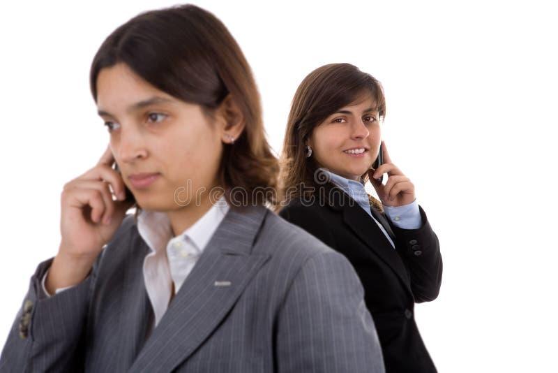 Onderneemster twee die mobiele telefoons houdt royalty-vrije stock foto's