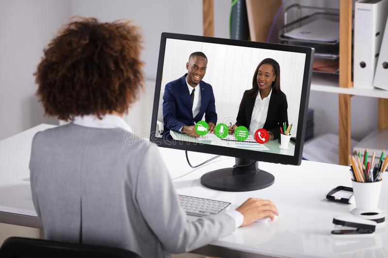 Onderneemster Video Conferencing Colleagues royalty-vrije stock afbeeldingen