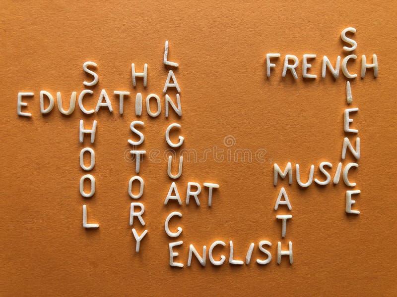 Onderwijs, creatief concept, kruiswoordraadselwoorden stock foto