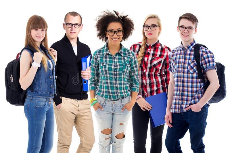 Onderwijsconcept - tieners of studenten status geïsoleerd op w royalty-vrije stock afbeelding