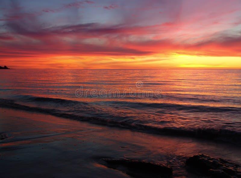 Ondes de coucher du soleil photo stock