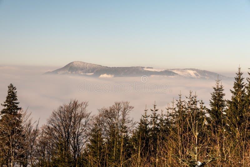 Ondrejnik mountain ridge with highest Skalka hill in Podbeskydska vrchovina mountains in Czech republic during winter. Ondrejnik mountain ridge with highest stock photo