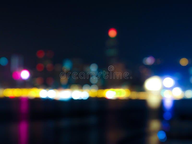 Onduidelijk beeld bokeh abstracte Stad van Hong Kong bij nachtachtergrond stock foto's