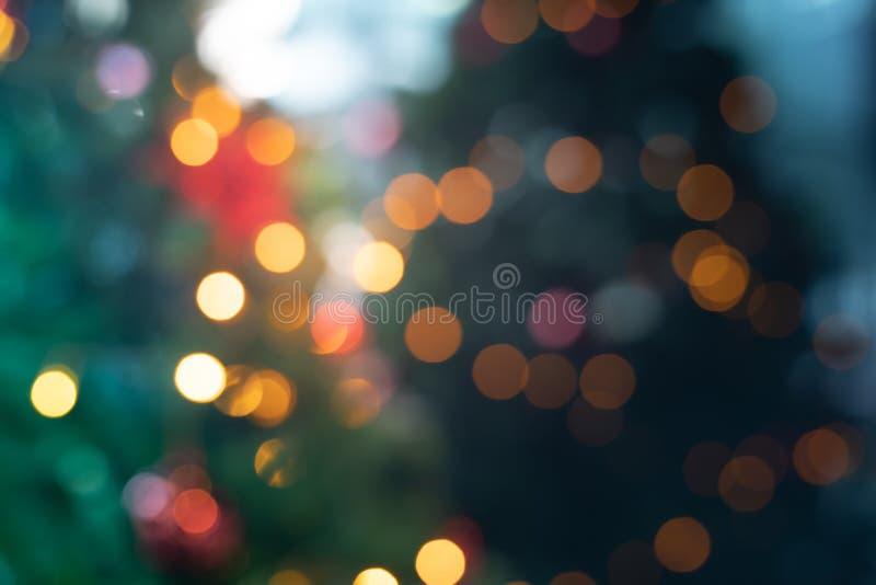 Onduidelijk beeld van Kerstmisboom met verlichting stock fotografie