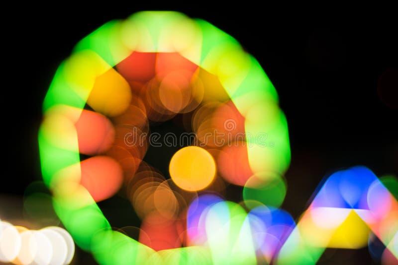 Onduidelijk beeldlicht van de achtergrond van het ferriswiel royalty-vrije stock afbeelding