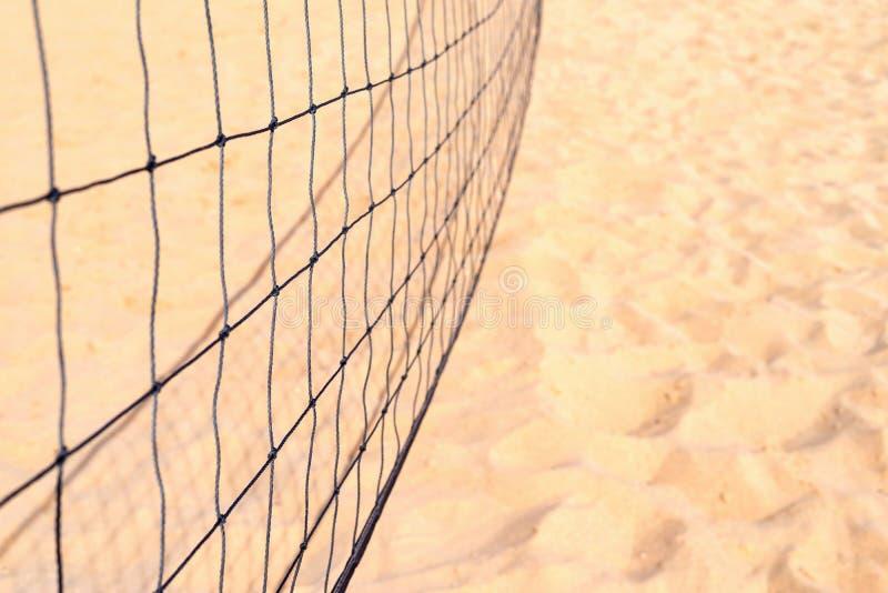 Onduidelijk volleyballnet tegen achtergrond van zand stock fotografie