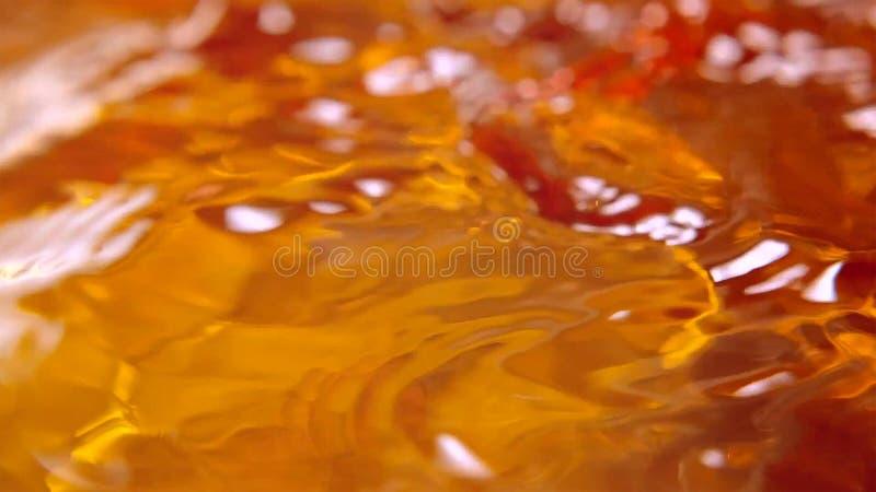 Ondulaciones del agua en fondo anaranjado fotografía de archivo libre de regalías