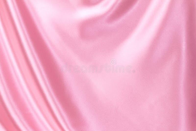 Ondulez le fond rose de luxe de tissu de soie ou de satin images stock