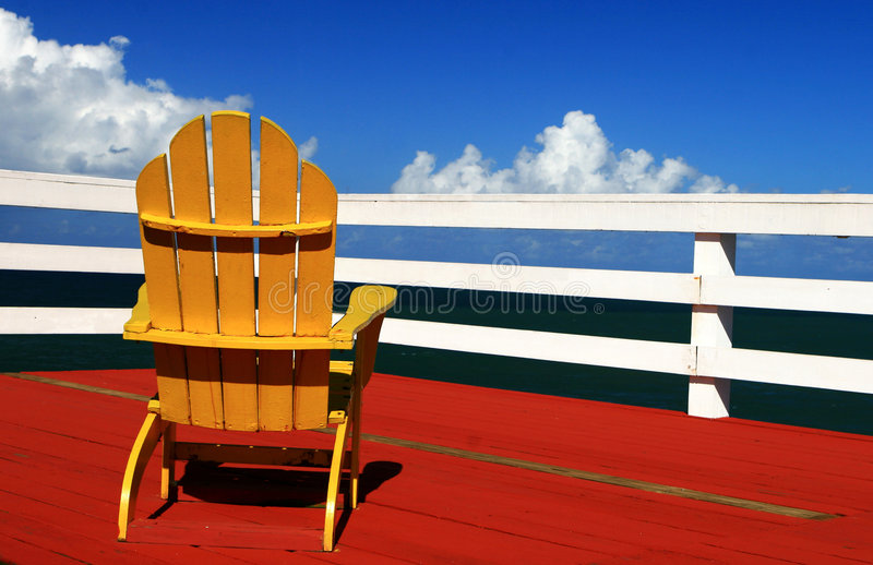 One. Yellow chair at a dock royalty free stock photo