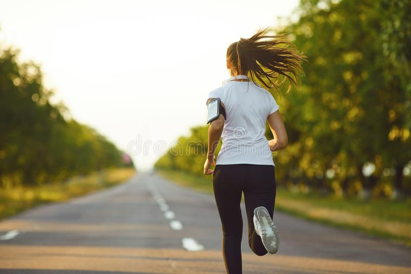 One active female runner running jogging on road royalty free stock photos