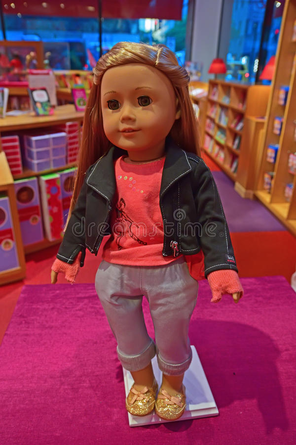 One of the American Girl characters on display in Fifth Avenue boutique shop, New York City royalty free stock images