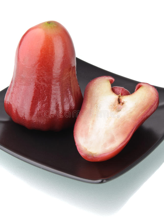 Free One And A Half Of Red Rose Apple On Black Plate Royalty Free Stock Photo - 18701165