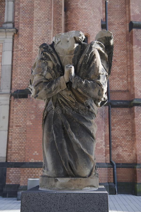 Angel torso in front of St. John`s Church, Dusseldorf royalty free stock photography