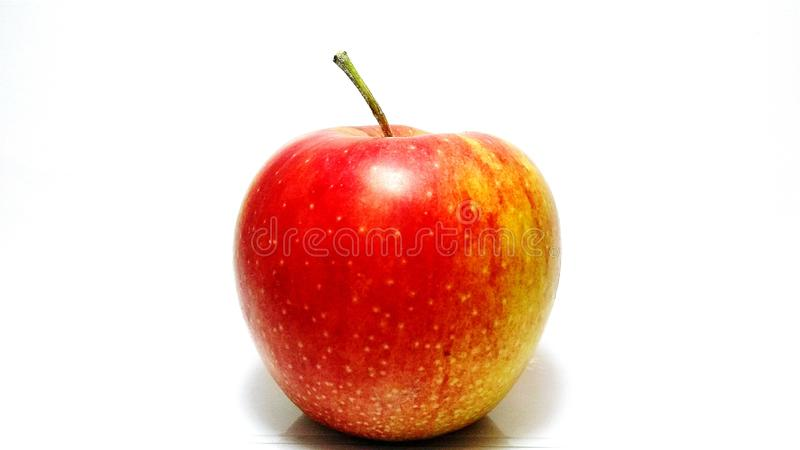 One apple in closeup on a white background stock photo