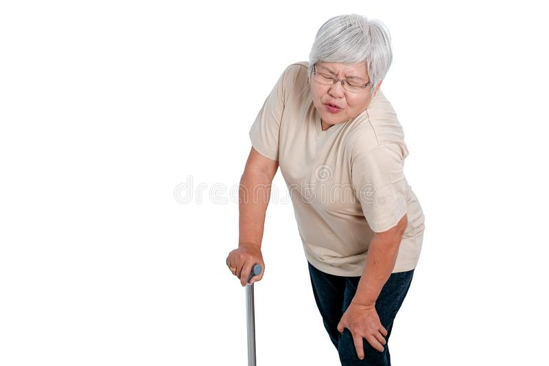 One Asian elderly woman express action of knee pain and isolate on white background with copy space royalty free stock photography