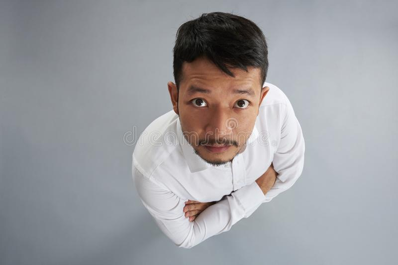 One asian man with crossed arms stock image